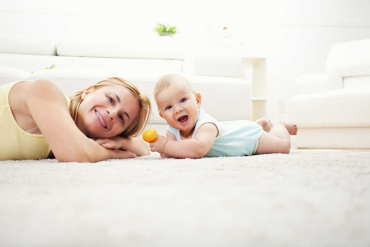 woman and baby on carpet